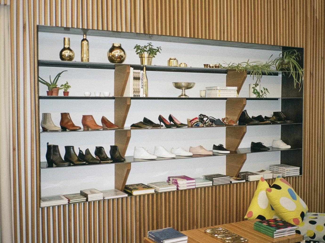 Food + Drink Style + Design Trip Ideas Weekend Getaways shelving shelf furniture bookcase display case interior design shoe store window different