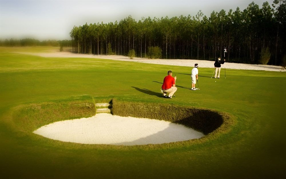 Golf Outdoors Sport grass tree structure green pitch and putt athletic game sports sport venue ball game golf course outdoor recreation recreation golf club baseball field individual sports