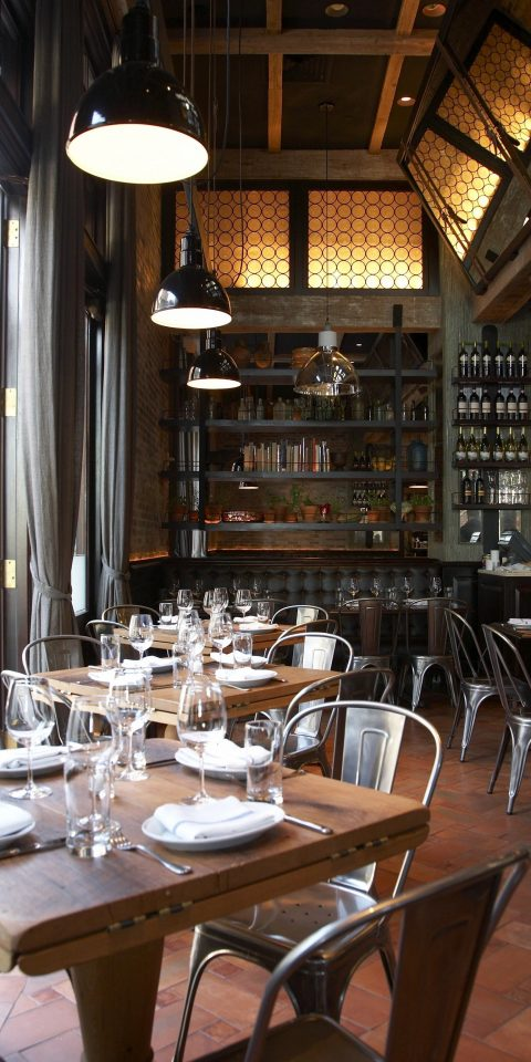 Food + Drink table indoor floor restaurant room meal Dining interior design Bar dining room café estate area Island dining table