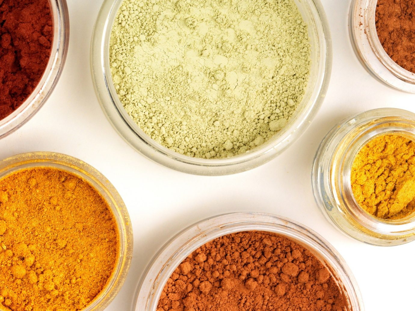 Style + Design food plate cup table turmeric indoor spice orange produce grass family spice mix curry powder powder crop flavor edible seed bread baked vegetable
