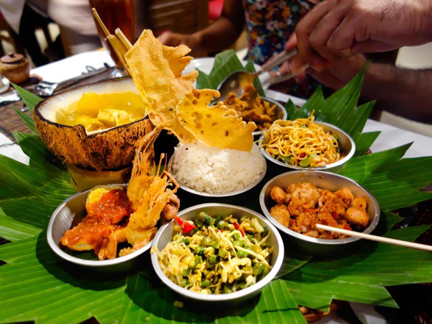 Jetsetter Guides person food table plate dish meal cuisine asian food chinese food buffet restaurant southeast asian food supper thai food lunch several snack food piece de resistance