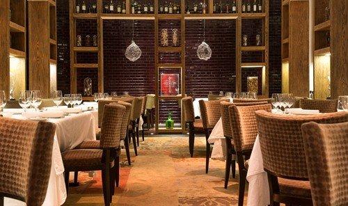 Food + Drink floor chair indoor restaurant window room function hall Bar interior design meal estate dining table