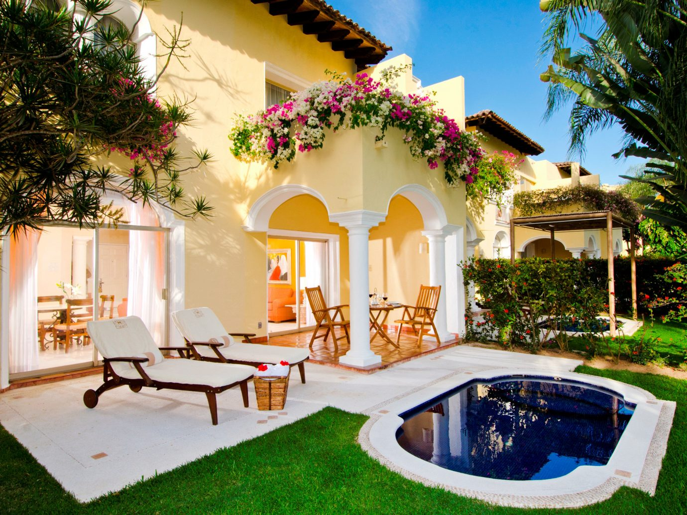 All-Inclusive Resorts Elegant Hotels Living Lounge Luxury Modern Pool tree grass outdoor house property estate home Villa swimming pool mansion vacation backyard hacienda Resort Courtyard cottage outdoor structure furniture