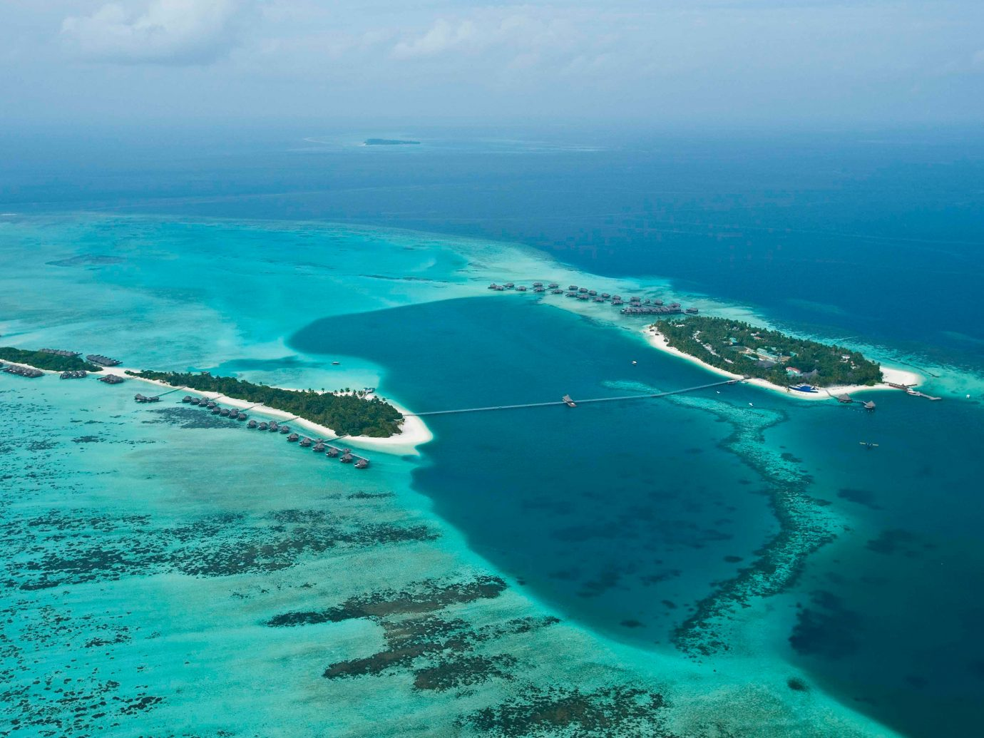 Hotels Ocean water sky outdoor geographical feature landform reef Nature Sea archipelago Coast islet Island blue cape wind wave atoll bay arctic ocean day