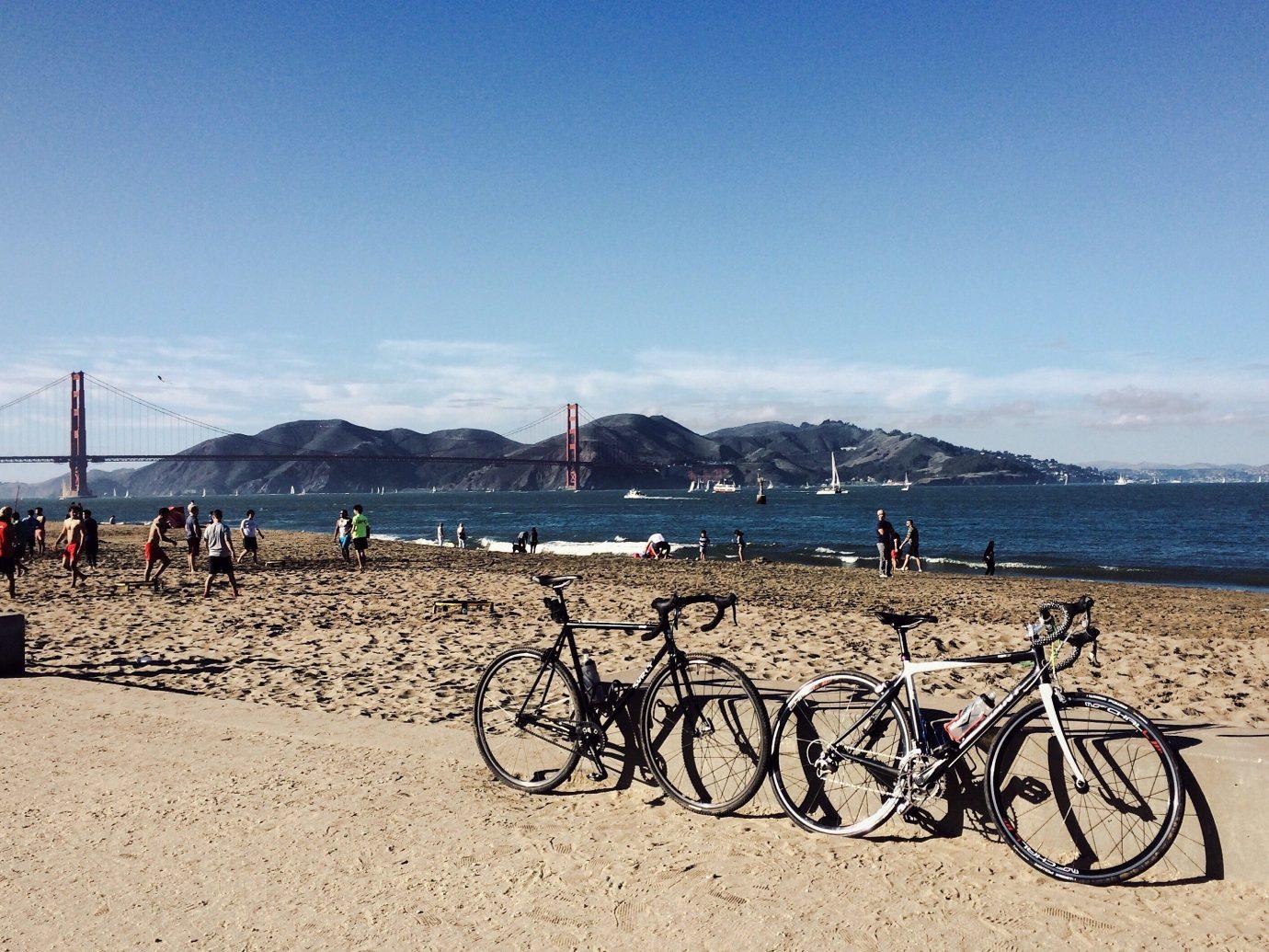 Trip Ideas sky outdoor ground Beach bicycle body of water Sea vehicle sand Coast shore landscape rack sandy soil
