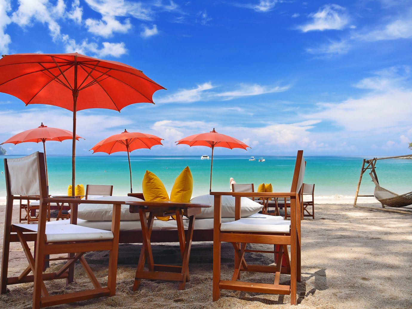 Beach Beachfront Hotels Lounge Ocean Outdoors Romance Tropical accessory sky umbrella chair leisure outdoor Nature vacation rain caribbean Sea Resort shore estate day several