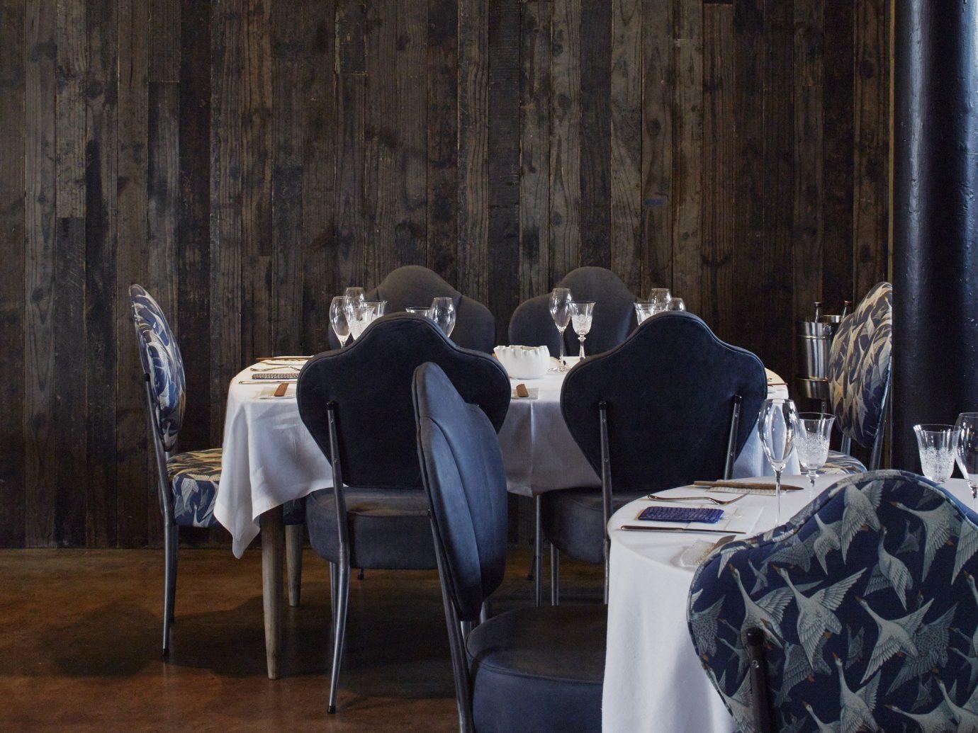 Food + Drink floor indoor room interior design wood lighting table furniture