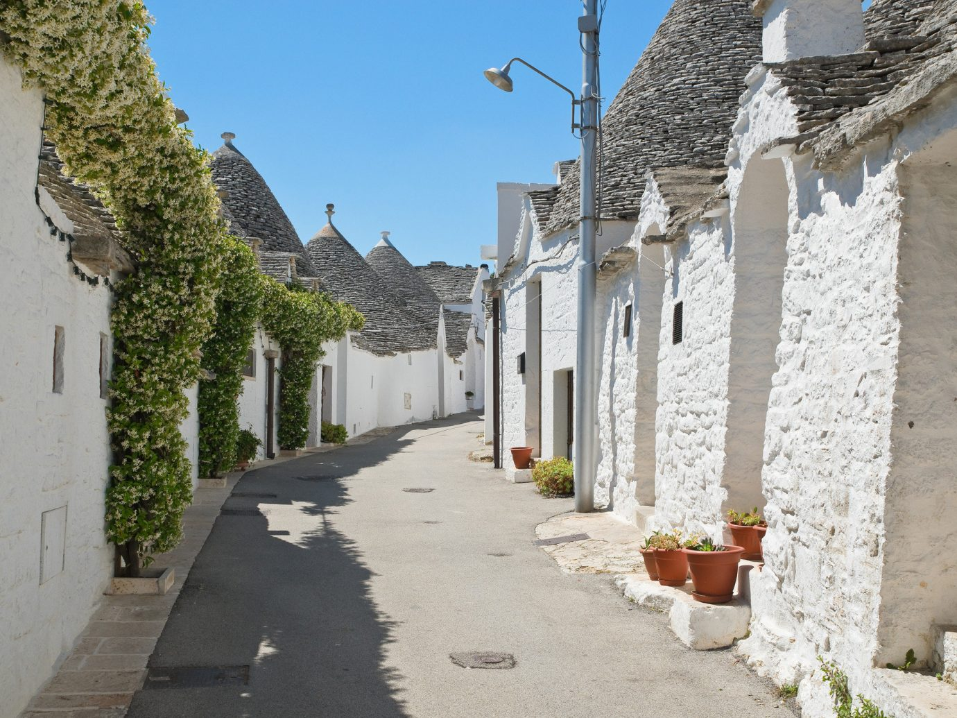 Trip Ideas outdoor tree ground Town alley street sky wall Village road neighbourhood stone City facade window house history cottage