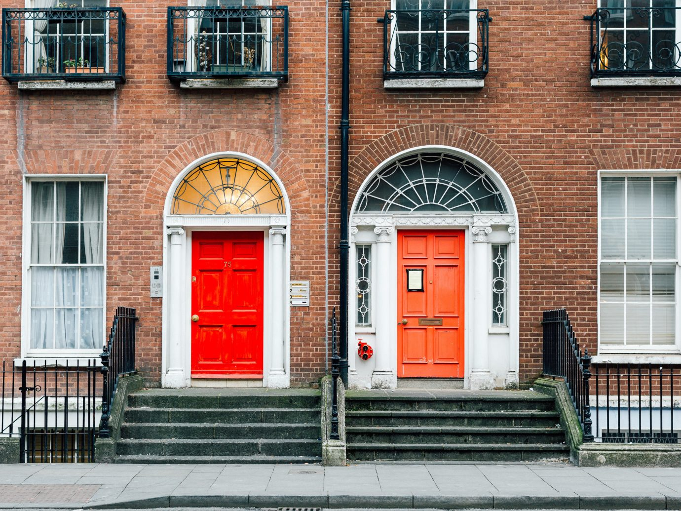 Travel Tips building outdoor color red urban area neighbourhood Town road City Architecture house wall facade brick window Downtown street door home