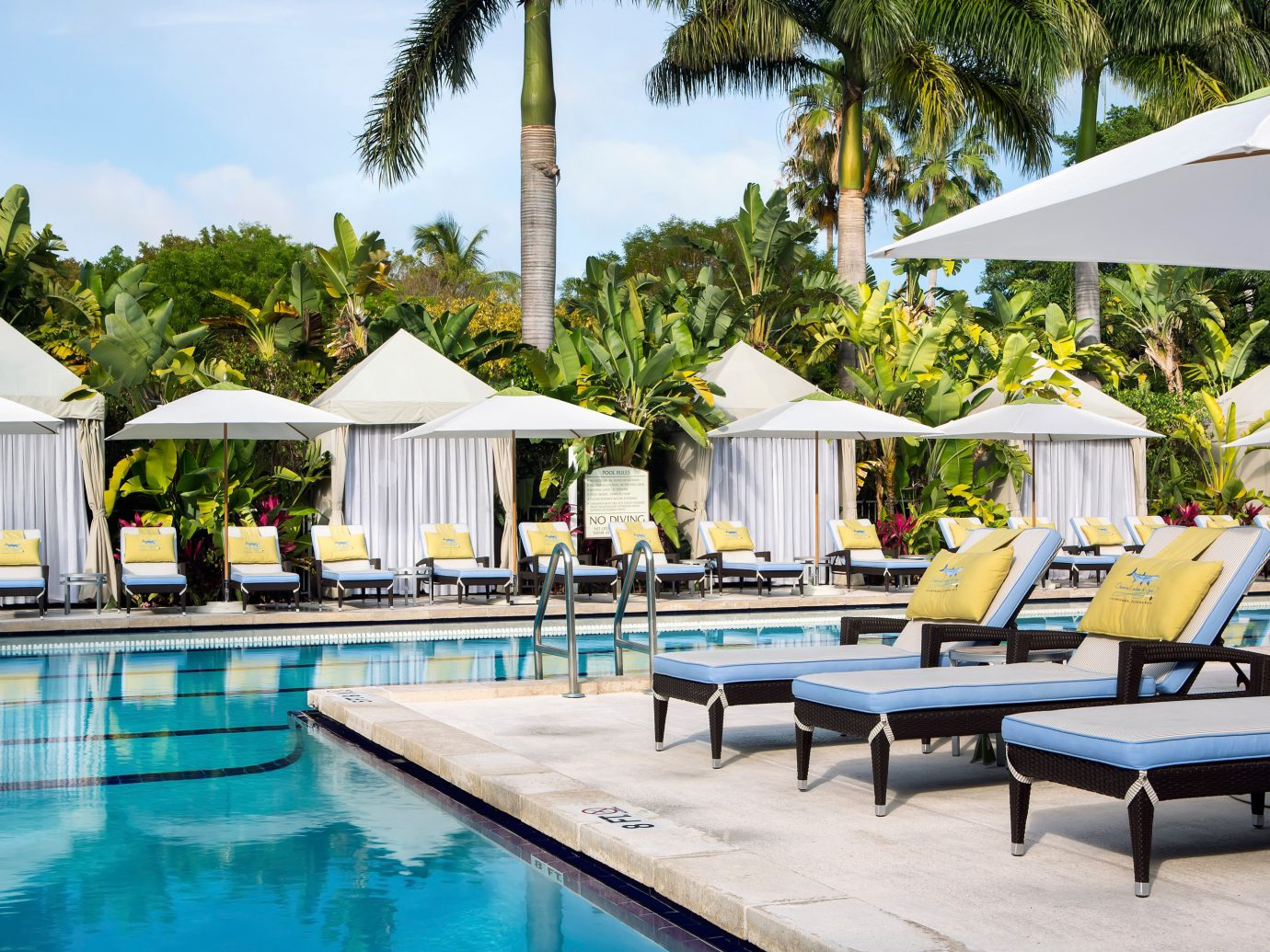 Hotels Island Lodge Lounge Patio Pool Trip Ideas Tropical tree outdoor table leisure chair swimming pool Resort estate Villa caribbean Deck swimming several