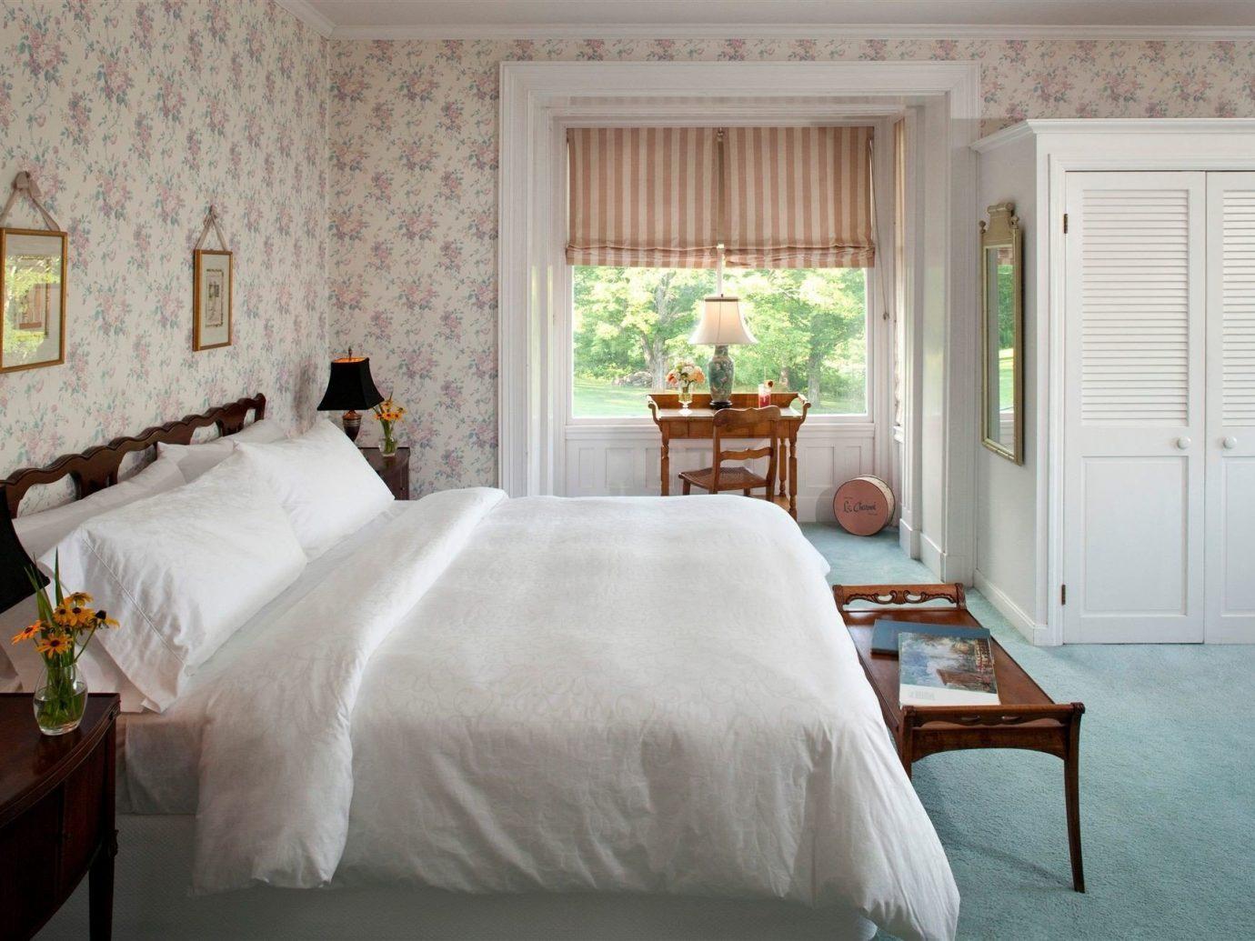 Hotels indoor wall floor room Bedroom bed window property interior design Suite cottage furniture estate hotel bed sheet bed frame real estate