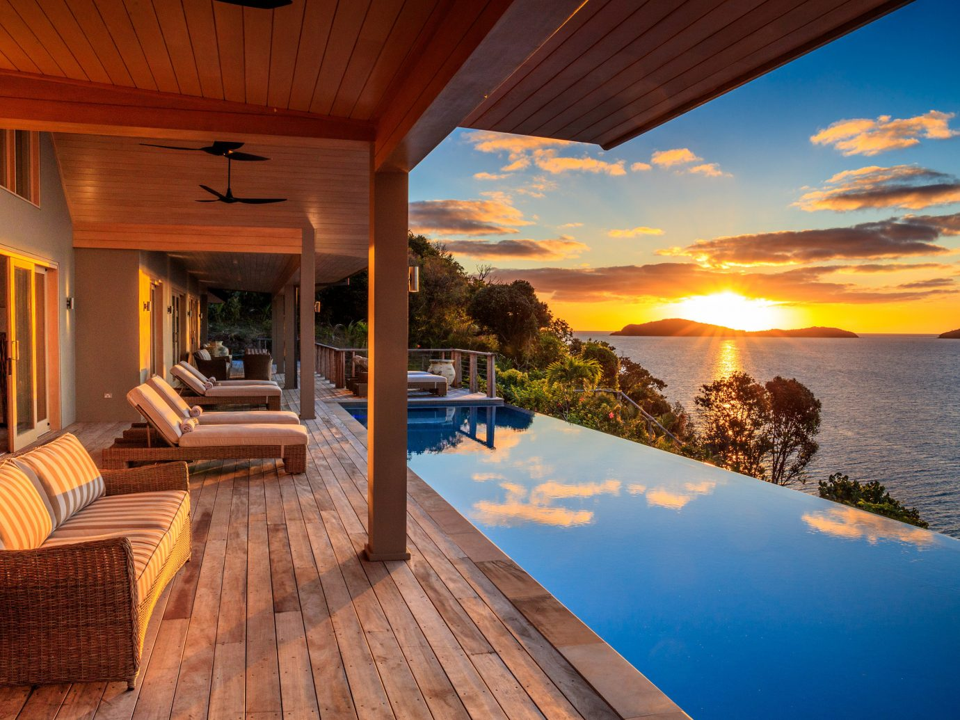 Boutique Hotels Hotels Luxury Travel property home building sky real estate estate Architecture Resort Villa house swimming pool lighting evening vacation wood apartment sunlight Sea hotel window porch interior design penthouse apartment leisure amenity Balcony hacienda Deck