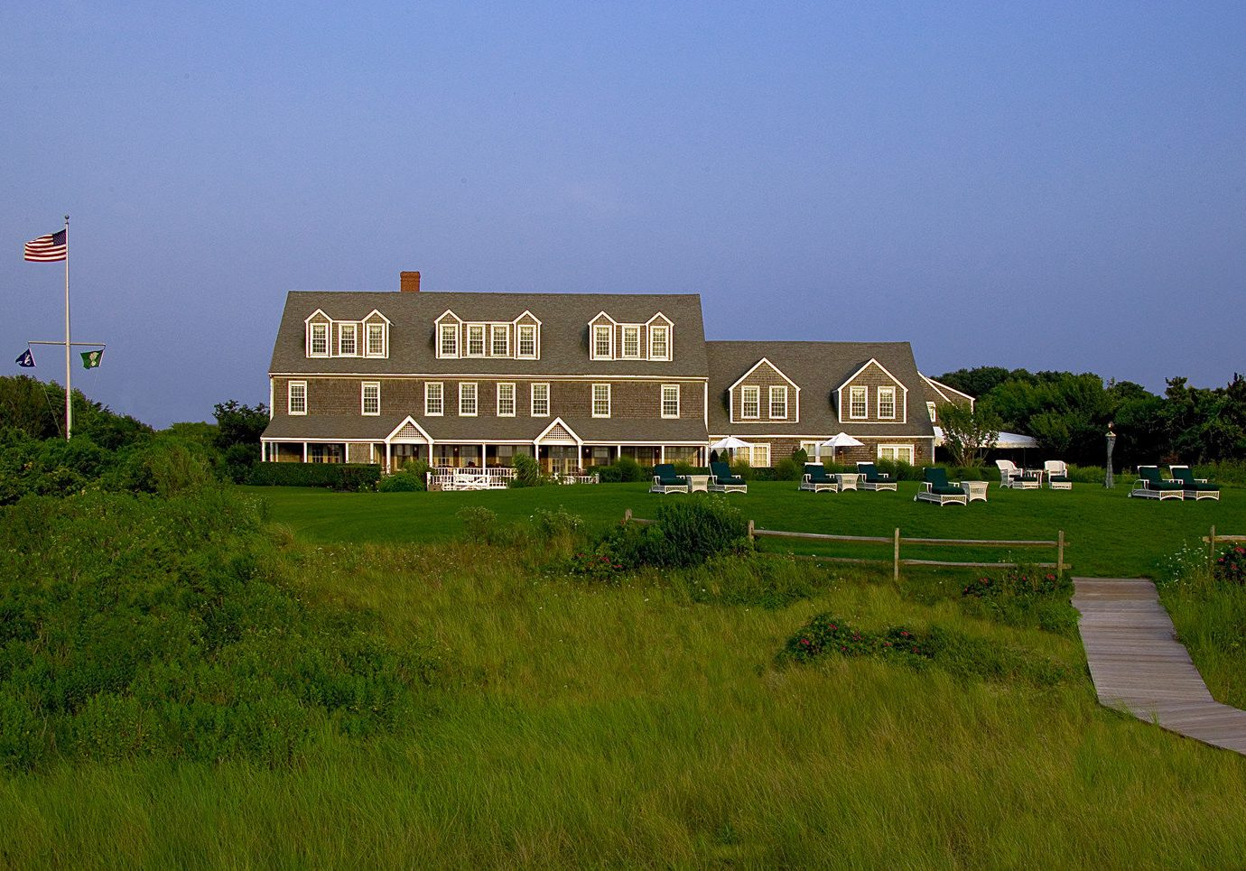 Hotels Romance grass sky outdoor house estate building field residential area rural area hill Farm home Coast suburb Village tower grassy lush sign