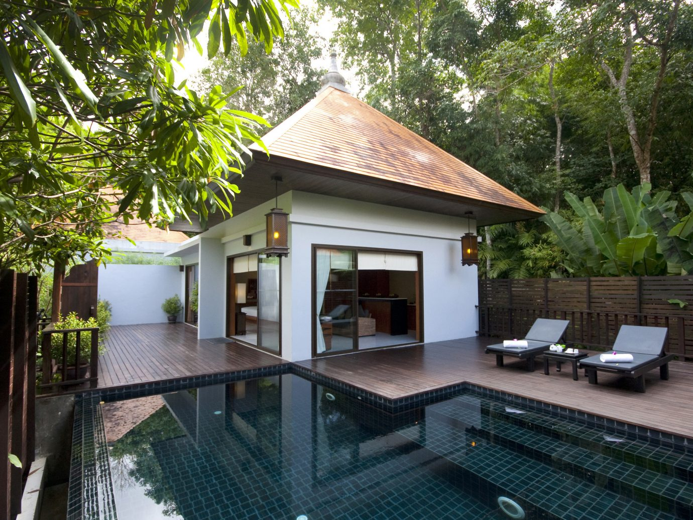Hotels tree outdoor property building house real estate Villa swimming pool home Resort estate cottage backyard outdoor structure area furniture several