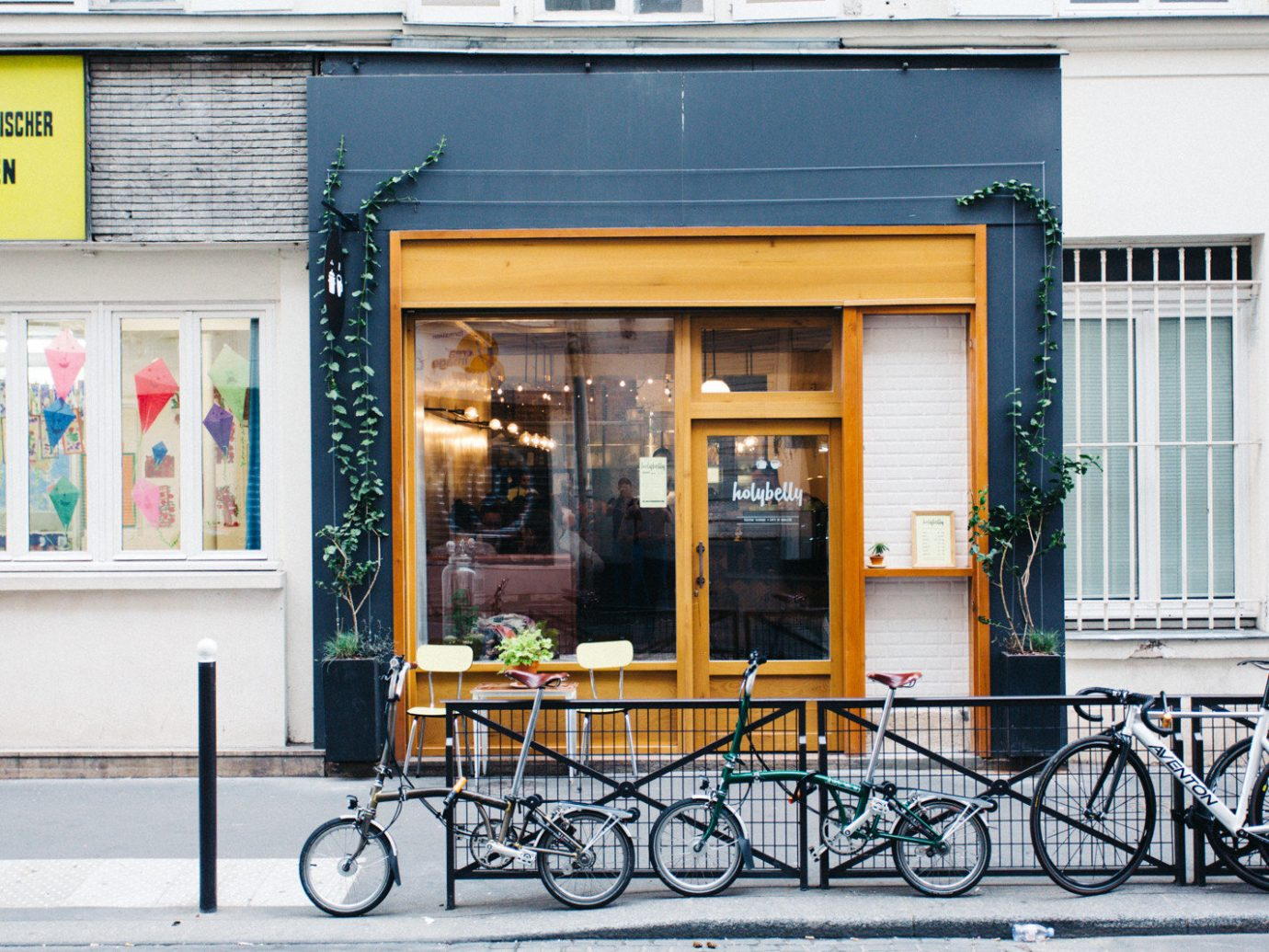Food + Drink outdoor bicycle building color parked yellow street sidewalk vehicle facade window interior design window covering porch cart