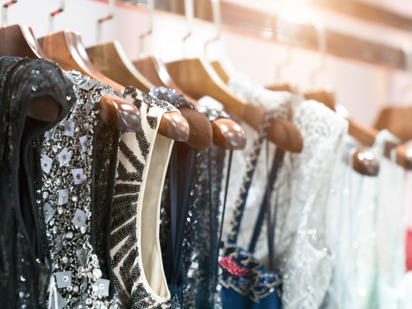 Style + Design Travel Tips Boutique fashion outerwear textile Winter clothes hanger