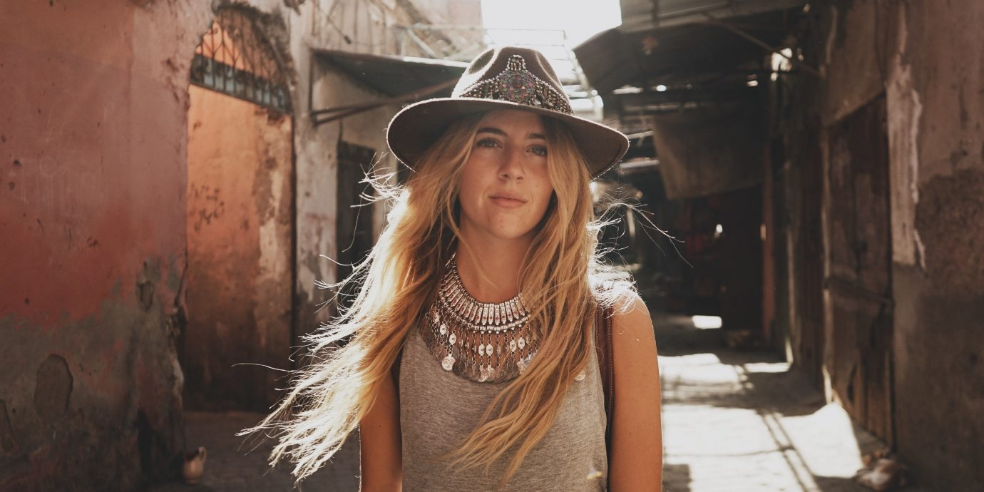 Influencers + Tastemakers Style + Design person outdoor girl headgear long hair photo shoot smile fun portrait photography