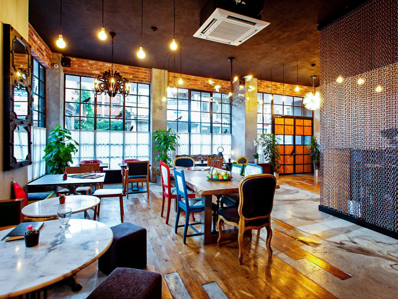 Boutique Hotels Hotels Luxury Travel indoor table ceiling room floor window Living restaurant interior design Dining real estate café furniture dining room Lobby area Bar dining table