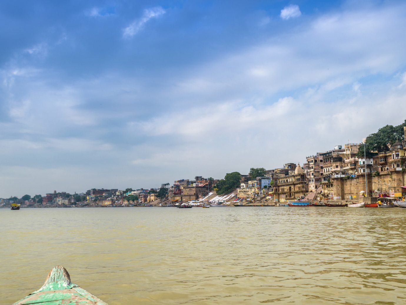 India Jaipur Jodhpur Trip Ideas sky water outdoor Boat waterway Sea body of water cloud River Coast tourism shore Beach bank vehicle City coastal and oceanic landforms Ocean Harbor boating tree Canal horizon Lake vacation bay channel recreation watercraft day