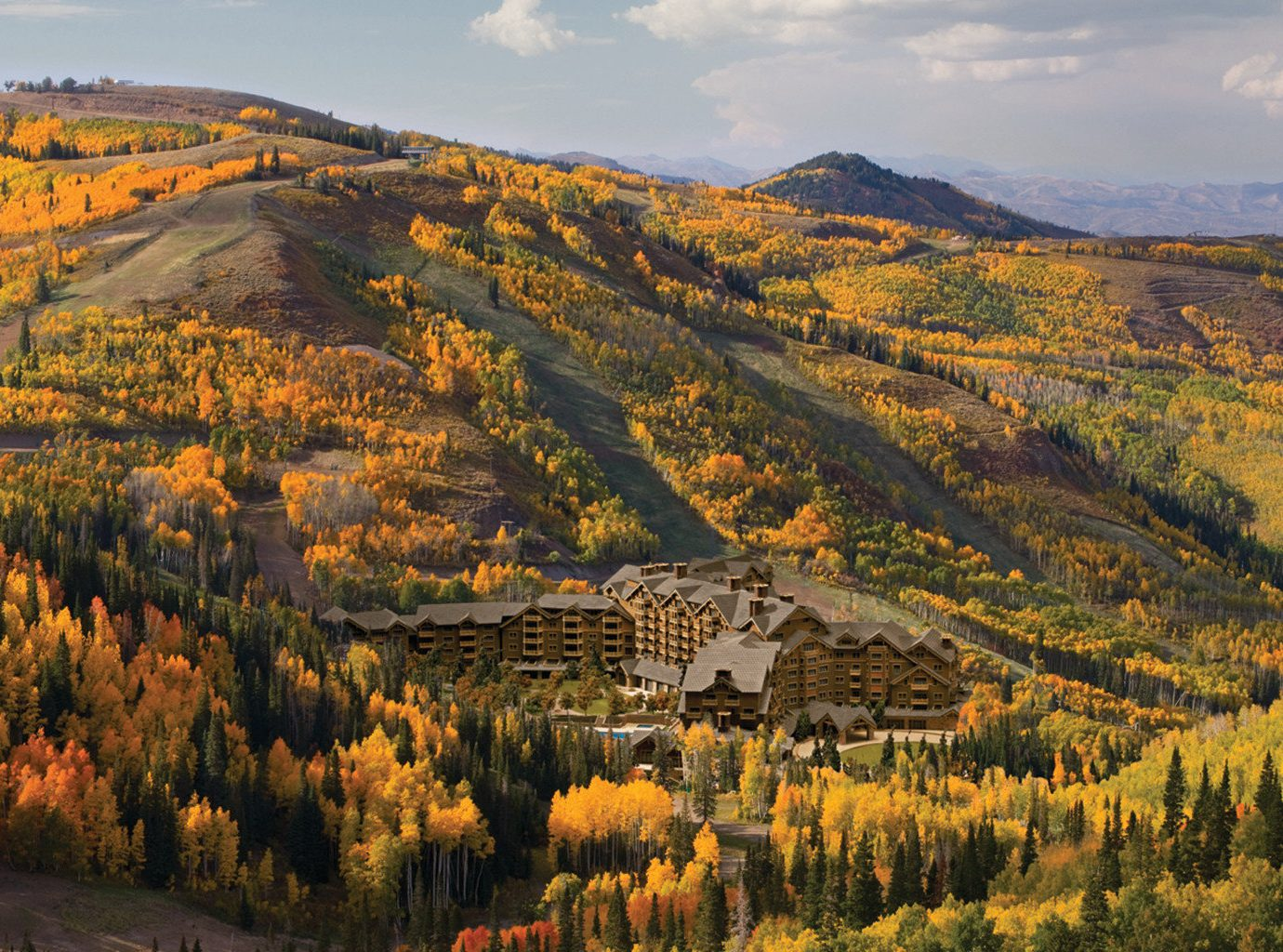 Fall Travel Mountains + Skiing National Parks Outdoors + Adventure Trip Ideas mountain sky Nature outdoor canyon valley grass mountainous landforms tree wilderness ecosystem autumn season hill agriculture leaf landscape rural area plateau aerial photography flower mountain range overlooking hillside lush