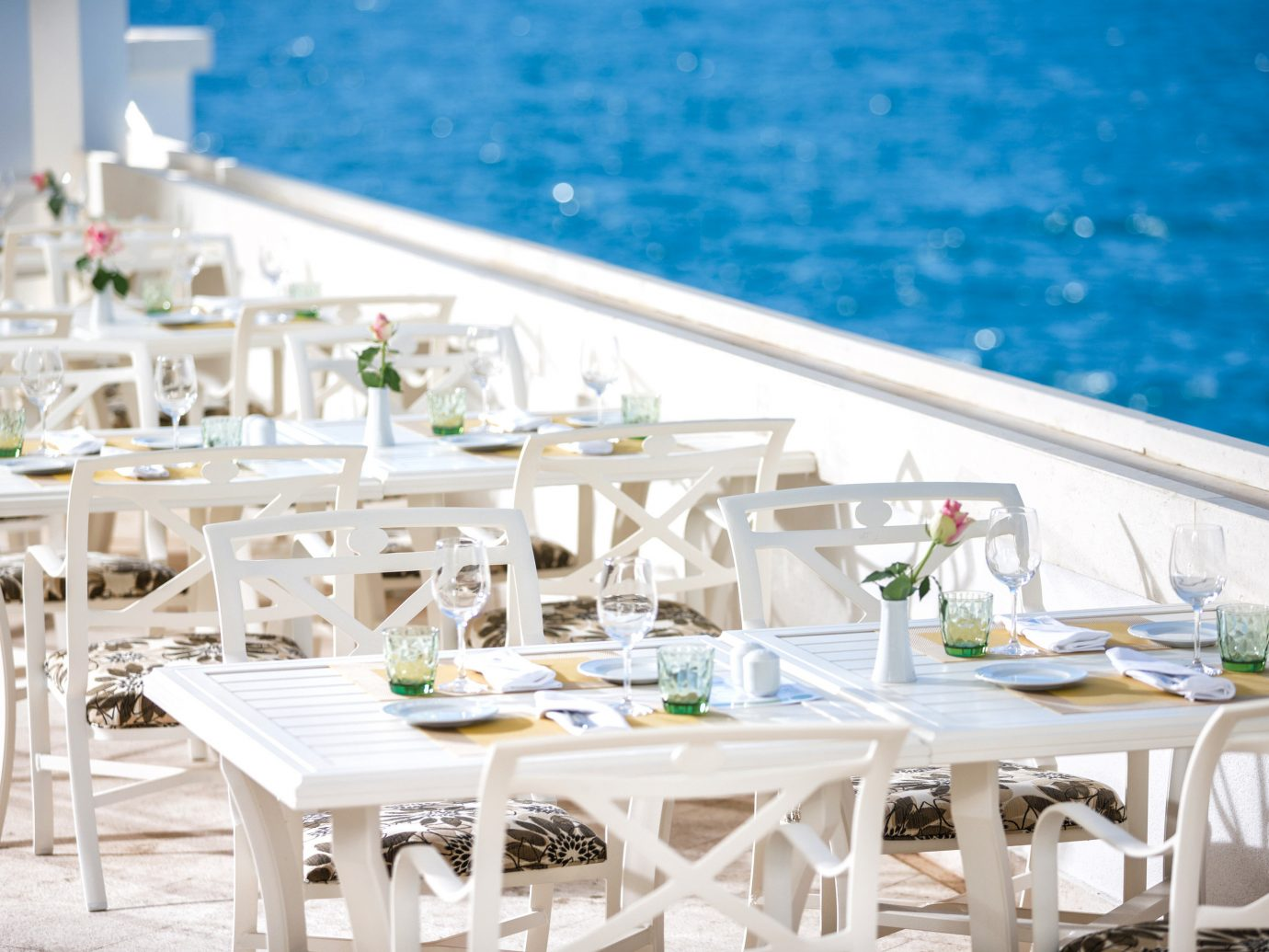 Travel Tips table restaurant meal white Party function hall Dining rehearsal dinner banquet wedding reception Deck dining table
