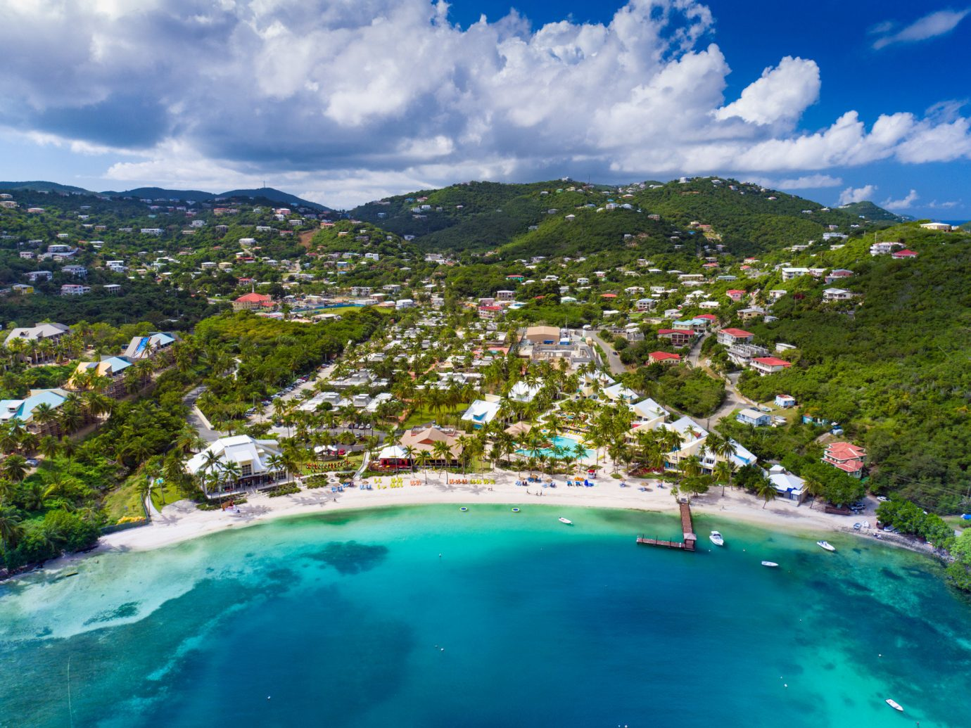Hotels Romance Travel Tips Trip Ideas sky outdoor water Nature landform geographical feature mountain Sea reef Coast Ocean vacation caribbean bay landscape Lagoon blue tropics Island cape mountain range swimming day