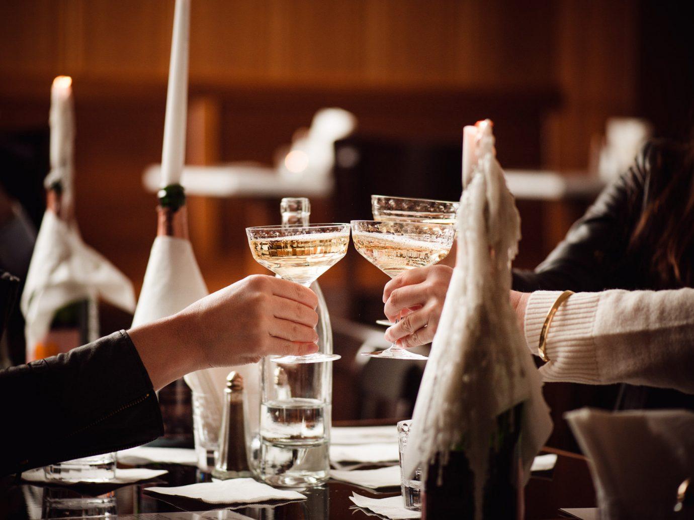 Boutique Hotels Romance Trip Ideas Winter table person indoor restaurant dinner meal rehearsal dinner sense Bar Drink