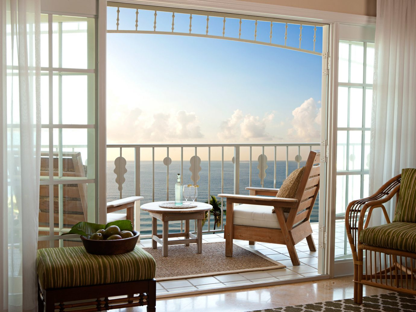 Balcony Modern Resort Trip Ideas Waterfront window floor indoor chair room Living property living room dining room building home interior design estate window covering hardwood porch real estate wood condominium cottage furniture farmhouse window treatment apartment dining table