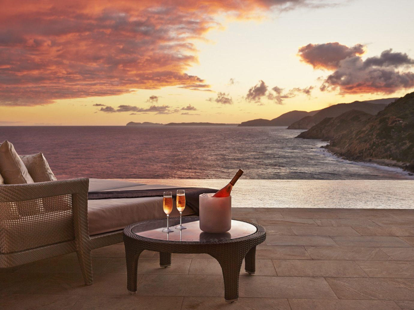 Beach calm champagne Drink drinks golden hour infinity pool isolation lounge chairs Luxury Ocean ocean view orange sky outdoor pool Pool private remote Romance Romantic sand serene Sunset Trip Ideas view white sands sky water outdoor mountain Sea morning evening Nature wood Coast overlooking