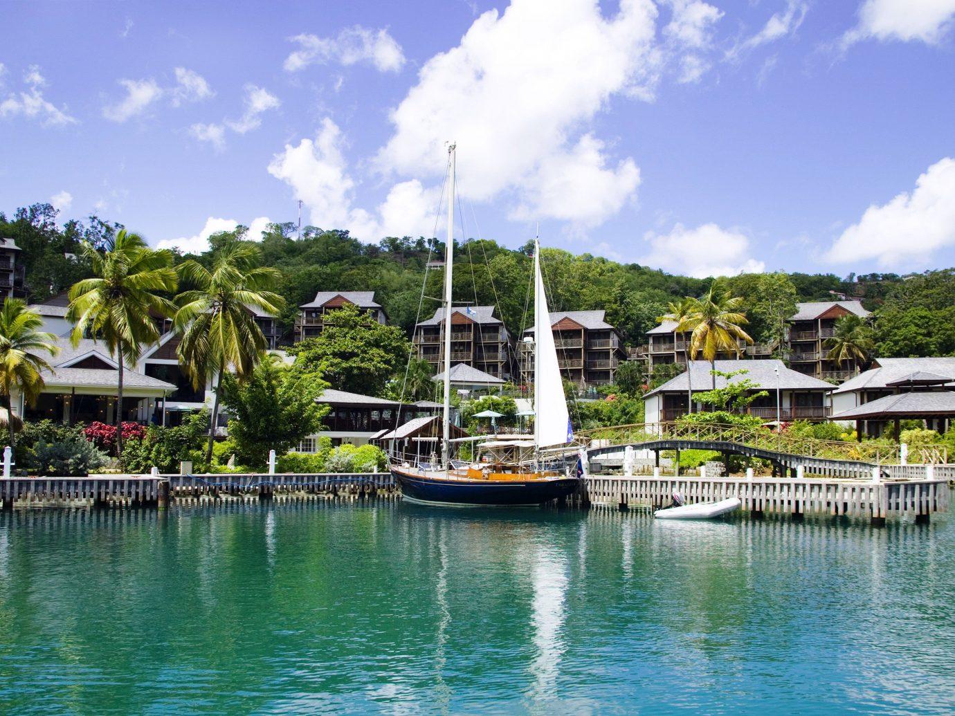 Hotels Luxury Travel sky outdoor water Boat marina scene dock Sea Resort vacation tourism bay Harbor vehicle Lagoon caribbean docked boating Lake Island day