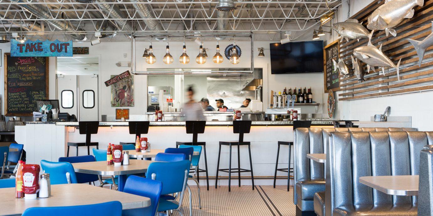 Food + Drink indoor chair floor ceiling restaurant room interior design table area furniture several