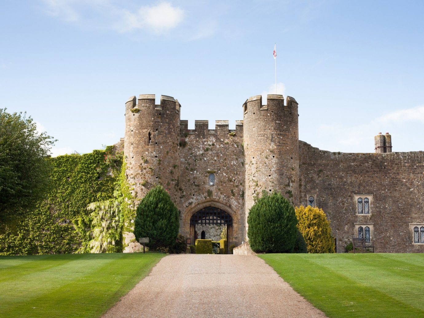 Hotels sky outdoor grass tree building castle château stately home brick estate fortification stone moat water castle monastery abbey old manor house