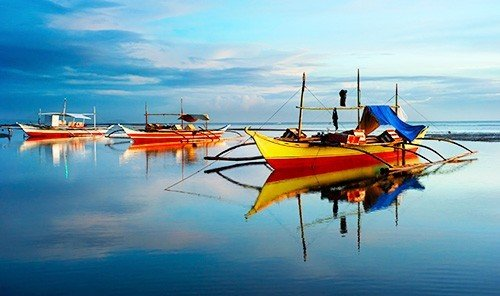 Food + Drink sky water Boat outdoor long tail boat vehicle watercraft rowing Sea orange boating Harbor airplane proa colored day