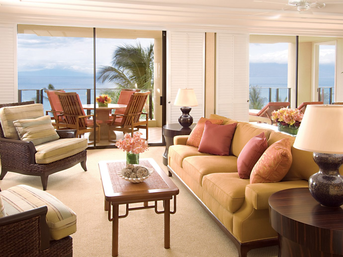 Balcony Beach Boutique Hotels Hotels Island Living Luxury Travel Scenic views Tropical indoor window floor table room sofa wall living room property home estate glass Suite interior design real estate condominium Villa nice furniture cottage apartment window covering dining room flat area