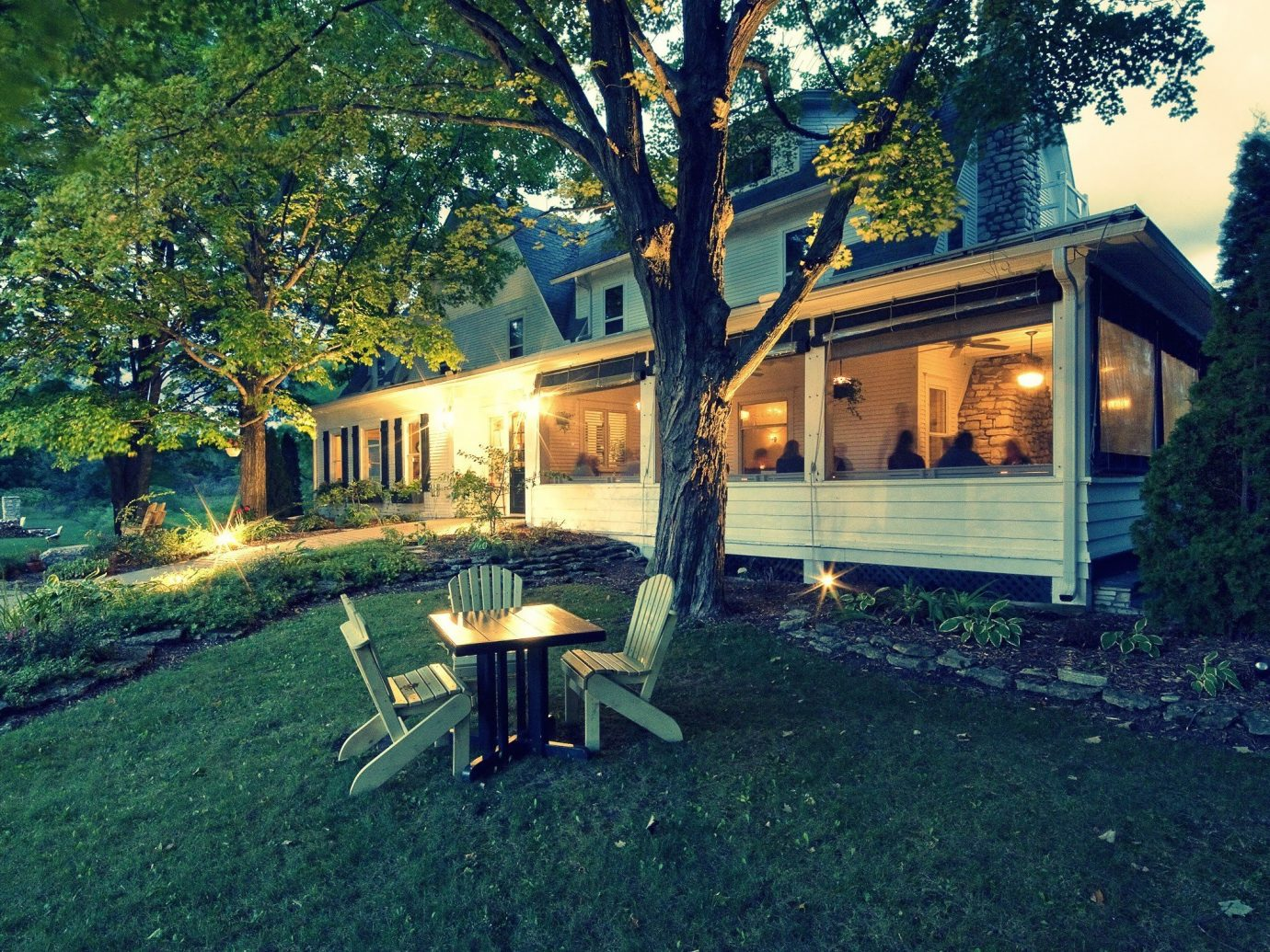 Trip Ideas Weekend Getaways tree outdoor grass home house property cottage real estate log cabin estate landscape lawn farmhouse backyard evening hut plant outdoor structure facade