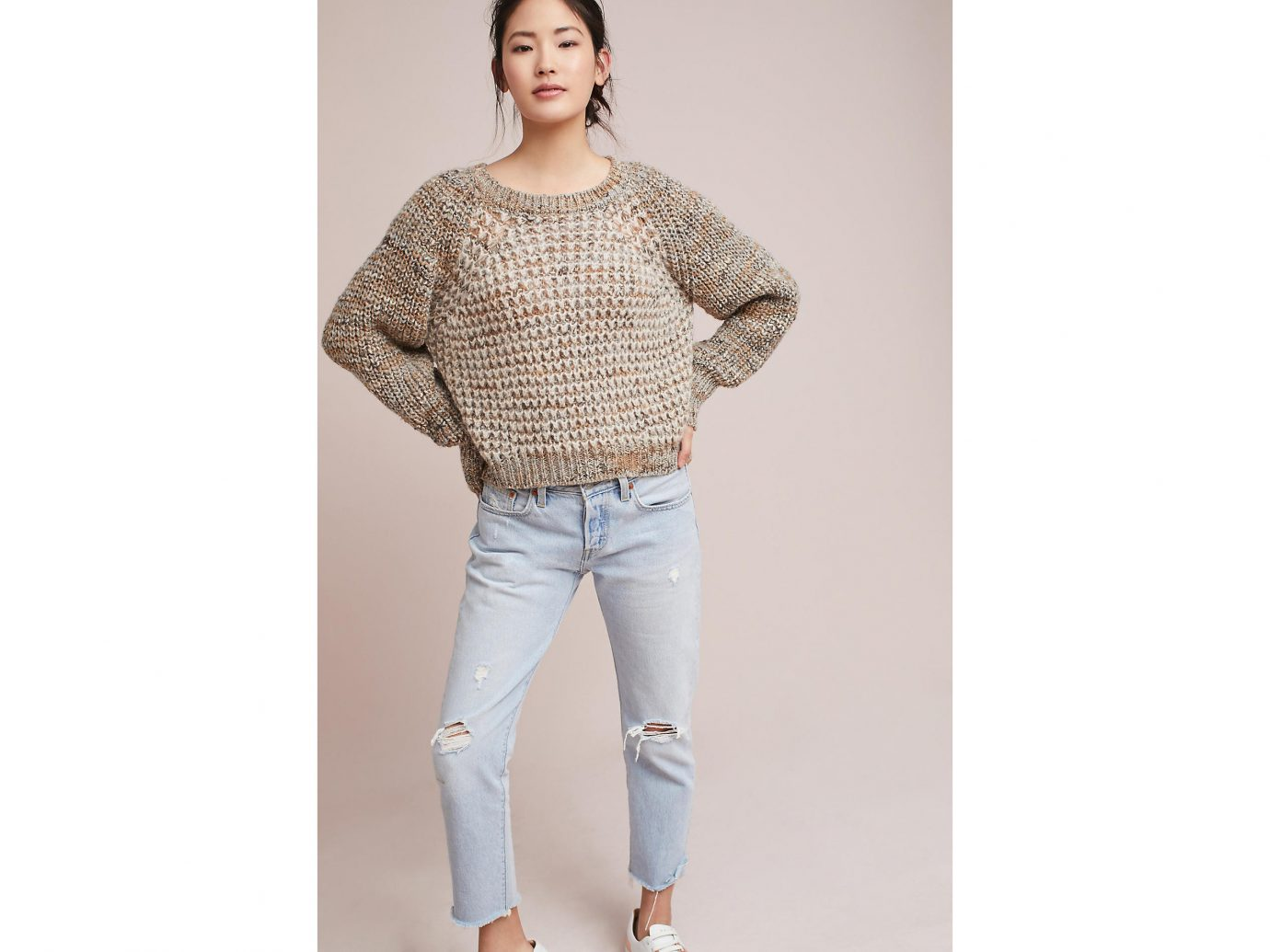 Travel Shop Travel Tips person clothing shoulder jeans fashion model sleeve neck outerwear posing blouse trousers waist beige sweater joint pattern trouser