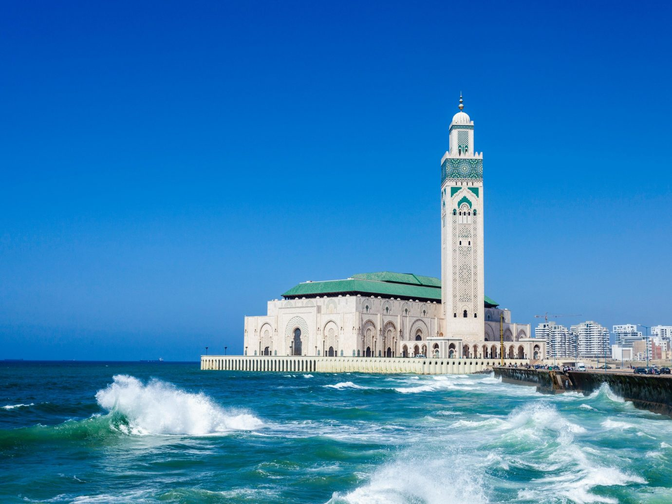 Arts + Culture Marrakech Morocco Style + Design Sea landmark sky wave promontory daytime Ocean coastal and oceanic landforms tower tourism water tourist attraction Coast wind wave building mosque