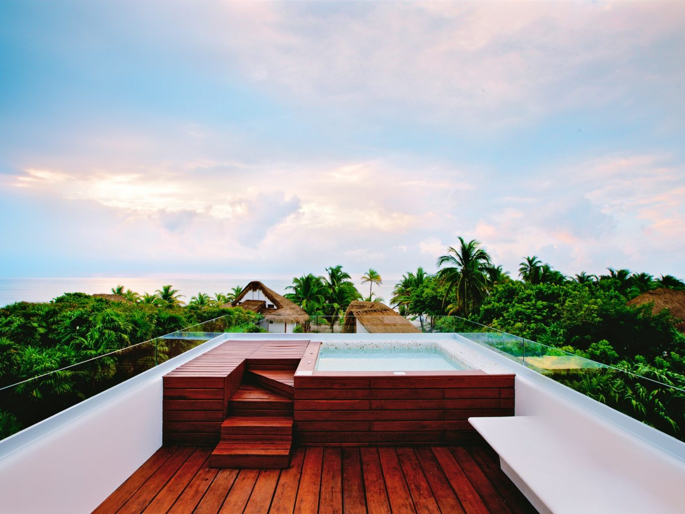 Boutique Hotels Hotels Mexico Tulum sky property Architecture real estate estate Resort house roof cloud Sea home water vacation Villa outdoor structure landscape