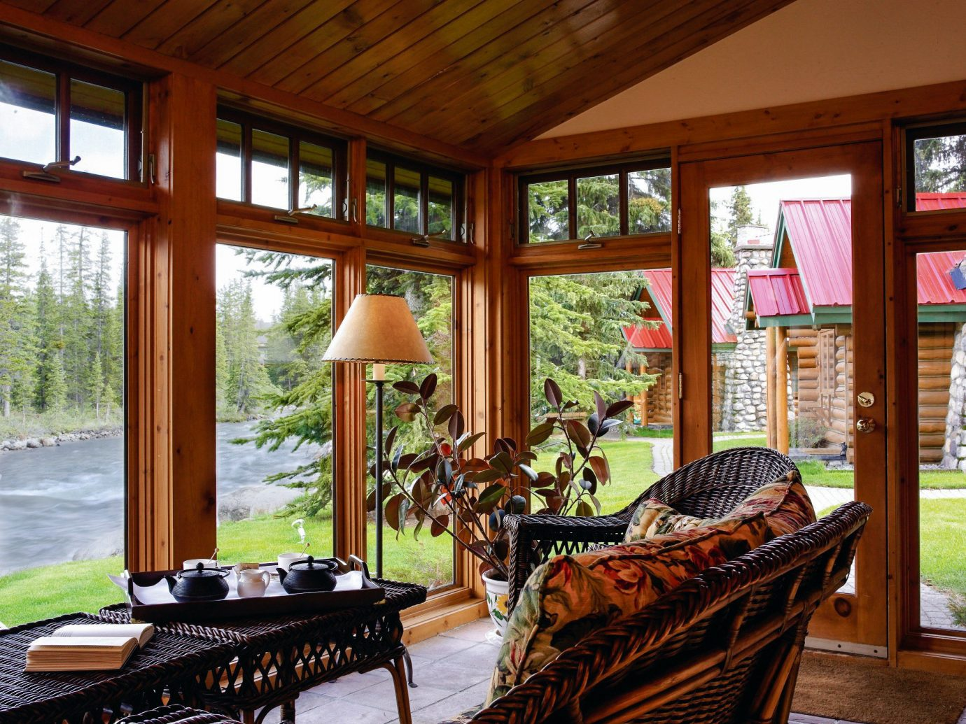 Alberta Boutique Hotels Canada Design Hotels Patio Rustic Scenic views indoor window ceiling room Living living room porch home interior design furniture real estate outdoor structure wood house estate door area several