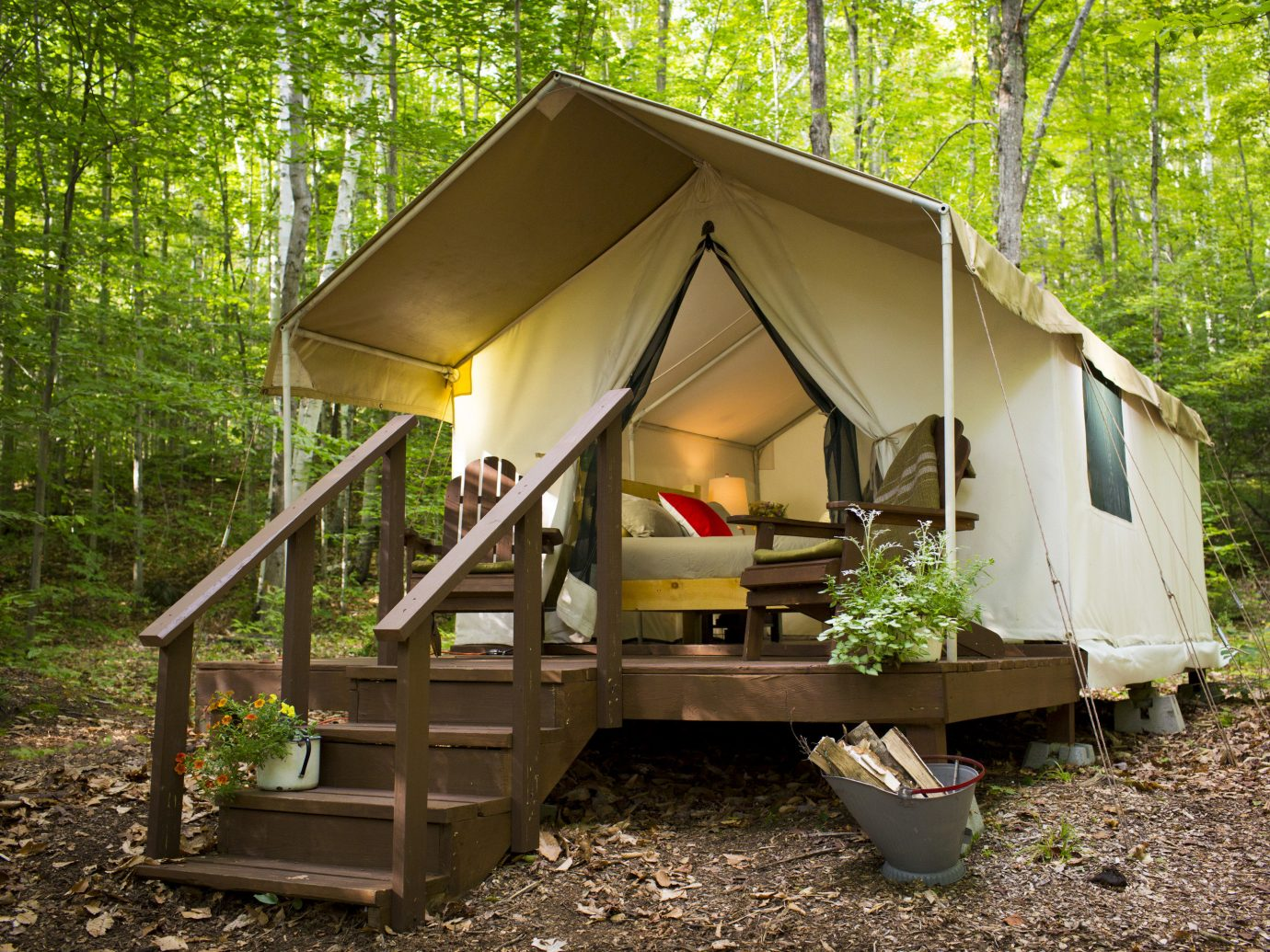 Glamping Outdoors + Adventure Weekend Getaways tree outdoor truck ground building tent house camping cottage shack home shed hut log cabin woodland wood porch area trunk trailer trash