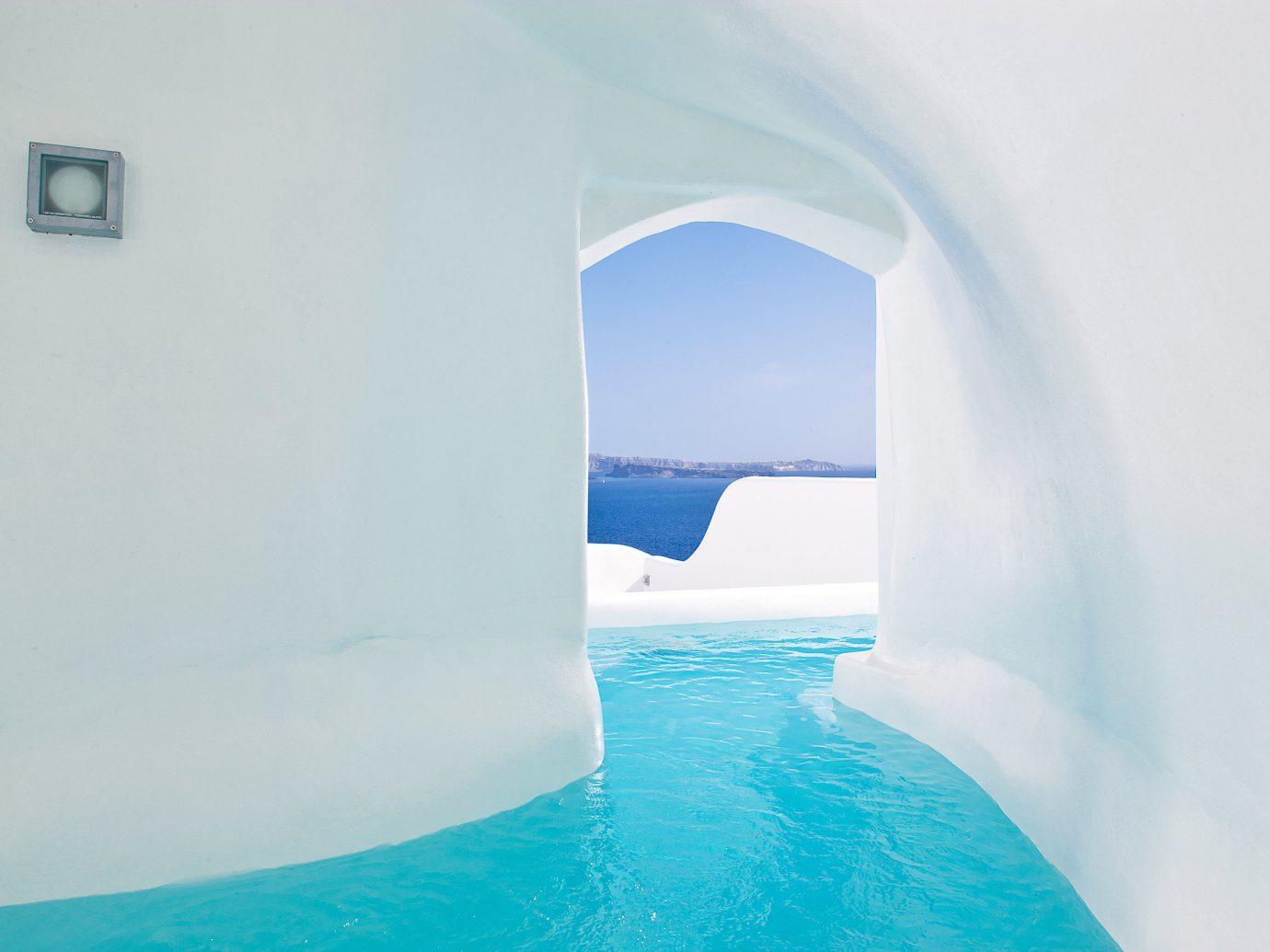 Bedroom Elegant Greece Historic Honeymoon Hot tub/Jacuzzi Hotels Luxury Romance Romantic Santorini Waterfront water blue swimming pool ice hotel