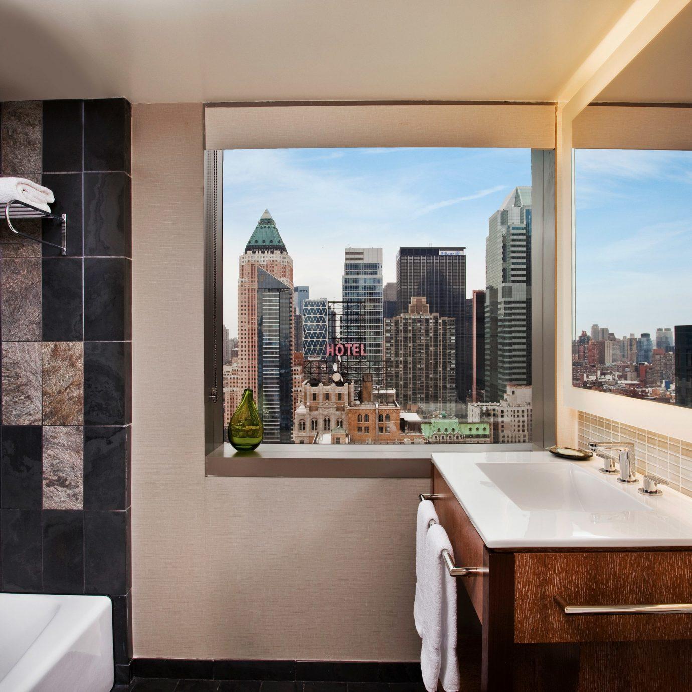 property house home bathroom condominium counter Suite Island tiled