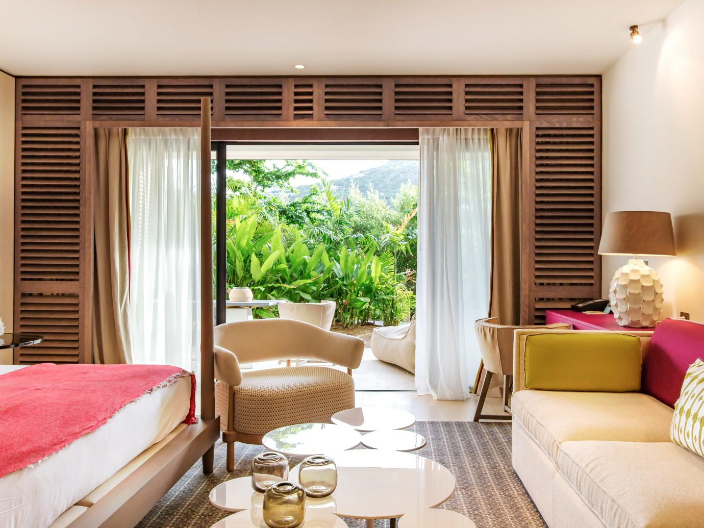 Hotels window indoor sofa room wall floor Living bed property living room Suite interior design estate Bedroom home condominium real estate cottage window covering furniture hotel decorated containing
