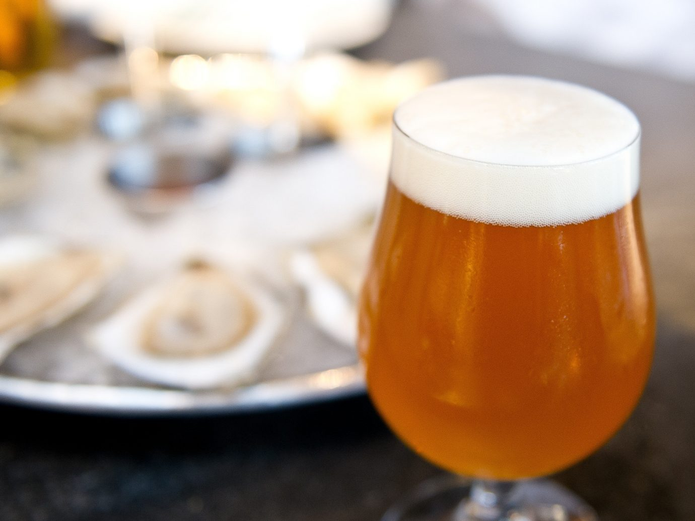Beer next to a platter of oysters