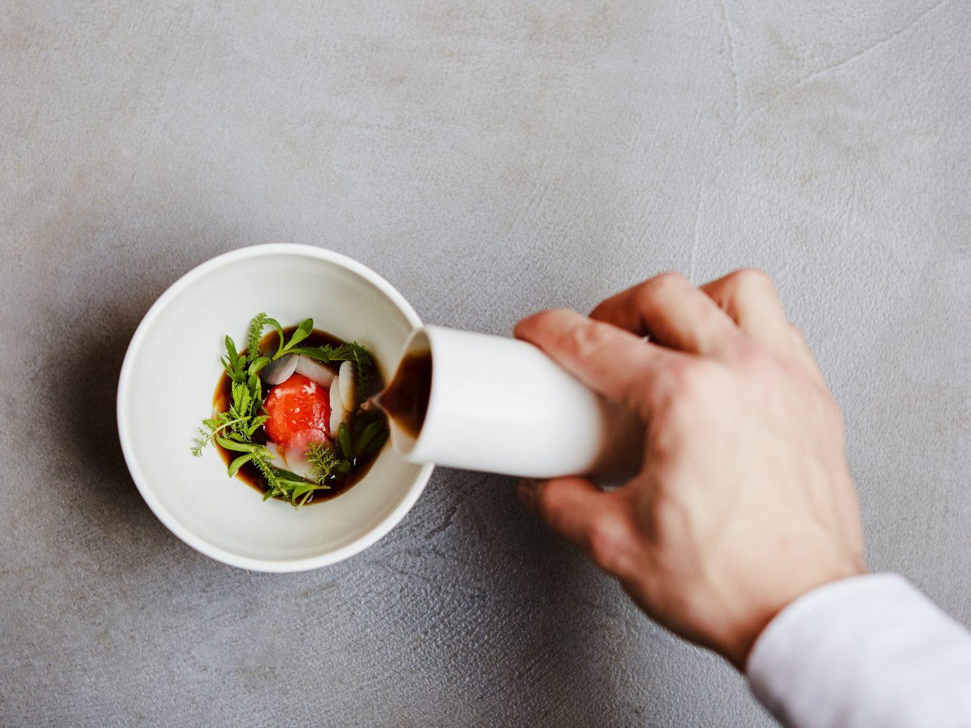 Food + Drink London person indoor tableware food dish dishware cutlery plate recipe hand bowl