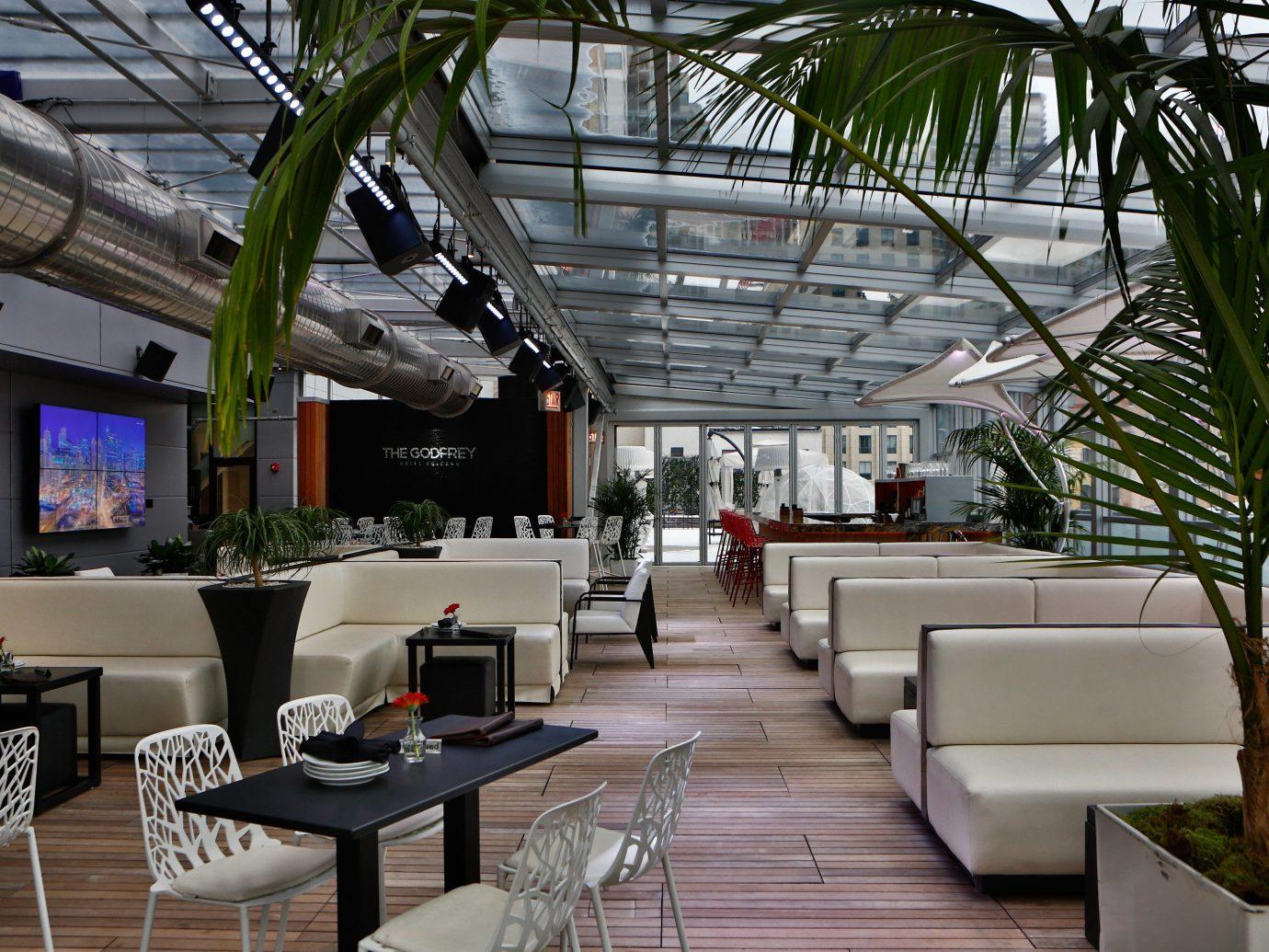 Food + Drink restaurant interior design home estate Resort Design outdoor structure Lobby condominium furniture plant