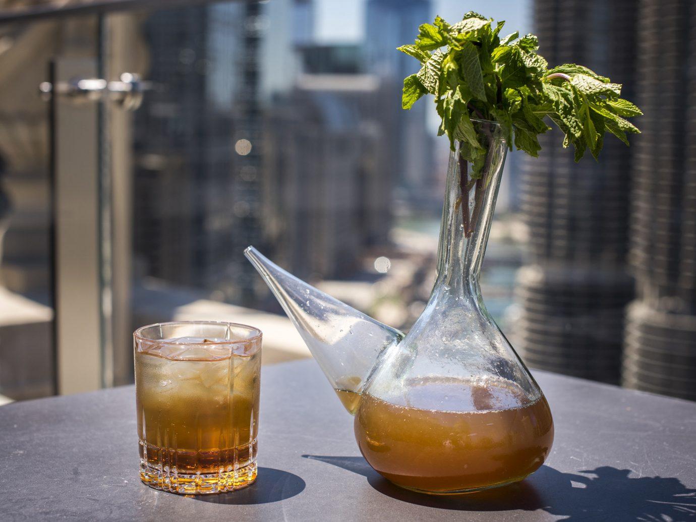 Food + Drink table cup glass Drink alcoholic beverage distilled beverage lighting liqueur cocktail food beverage
