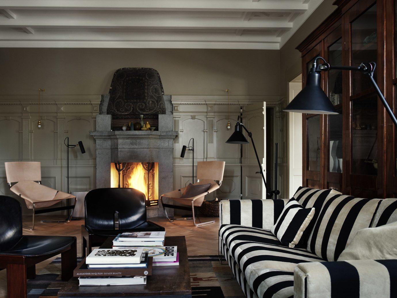 Design Hotels Stockholm Sweden indoor Living living room room interior design hearth home Fireplace ceiling wood burning stove furniture house interior designer leather