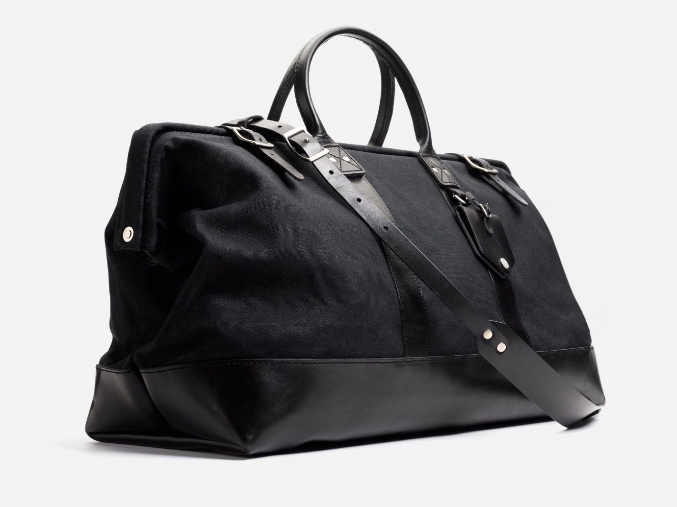 Style + Design bag black handbag accessory leather product shoulder bag hand luggage baggage luggage & bags product design brand case