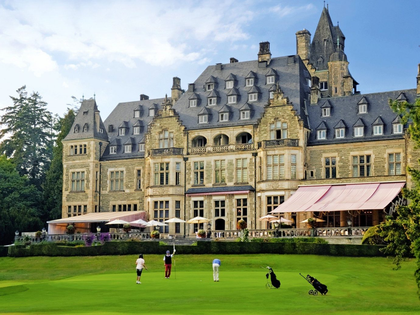Hotels Landmarks Luxury Travel tree grass outdoor sky stately home building château estate field park mansion castle manor house lawn residential area palace